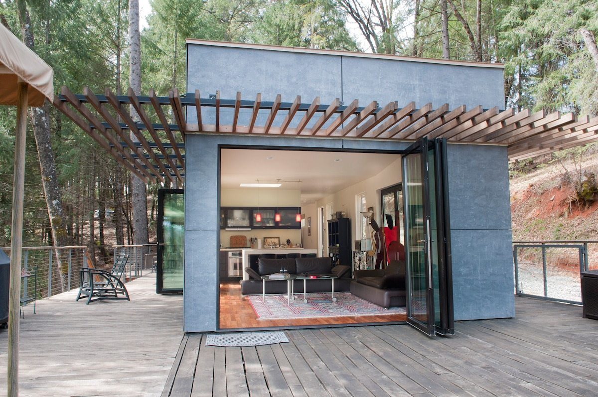 Green quot off grid glass house in grass valley