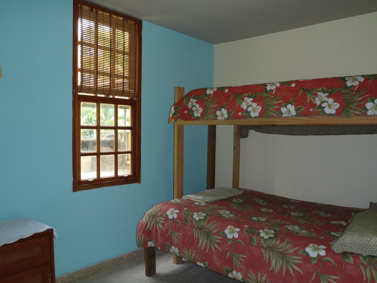 Our bunk bedroom is perfect for the rest of the family or extra guests.  The bottom bed is a full size, the top is a twin size.
