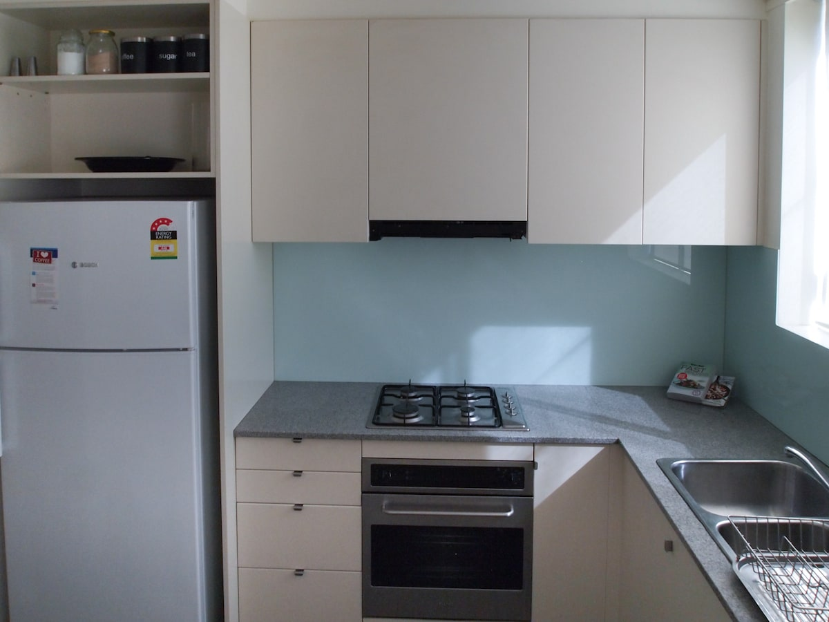 Fully outfitted kitchen with gas stove, oven and fridge