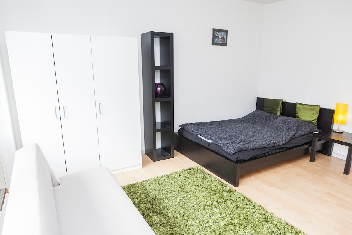 """Double bed with previous """"night table"""" and shelves and wardrobe"""