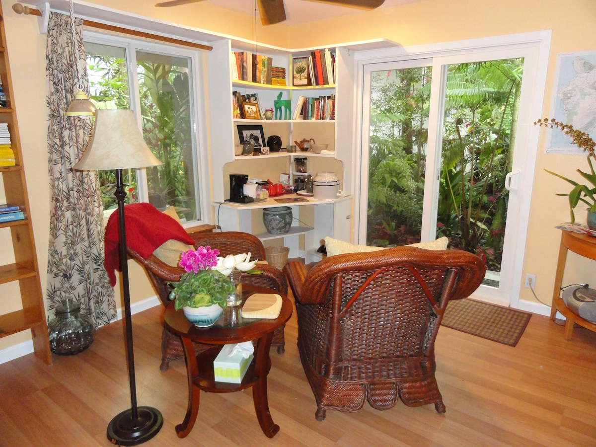 Relax in comfortable chairs in your sitting room, looking out on your private tropical garden.