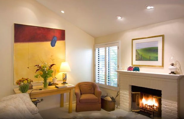 Relax in front of the living room's gas fireplace, no matter the season!