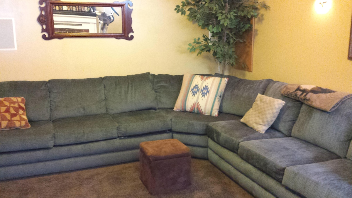 Large, very comfortable sectional couch in the basement.