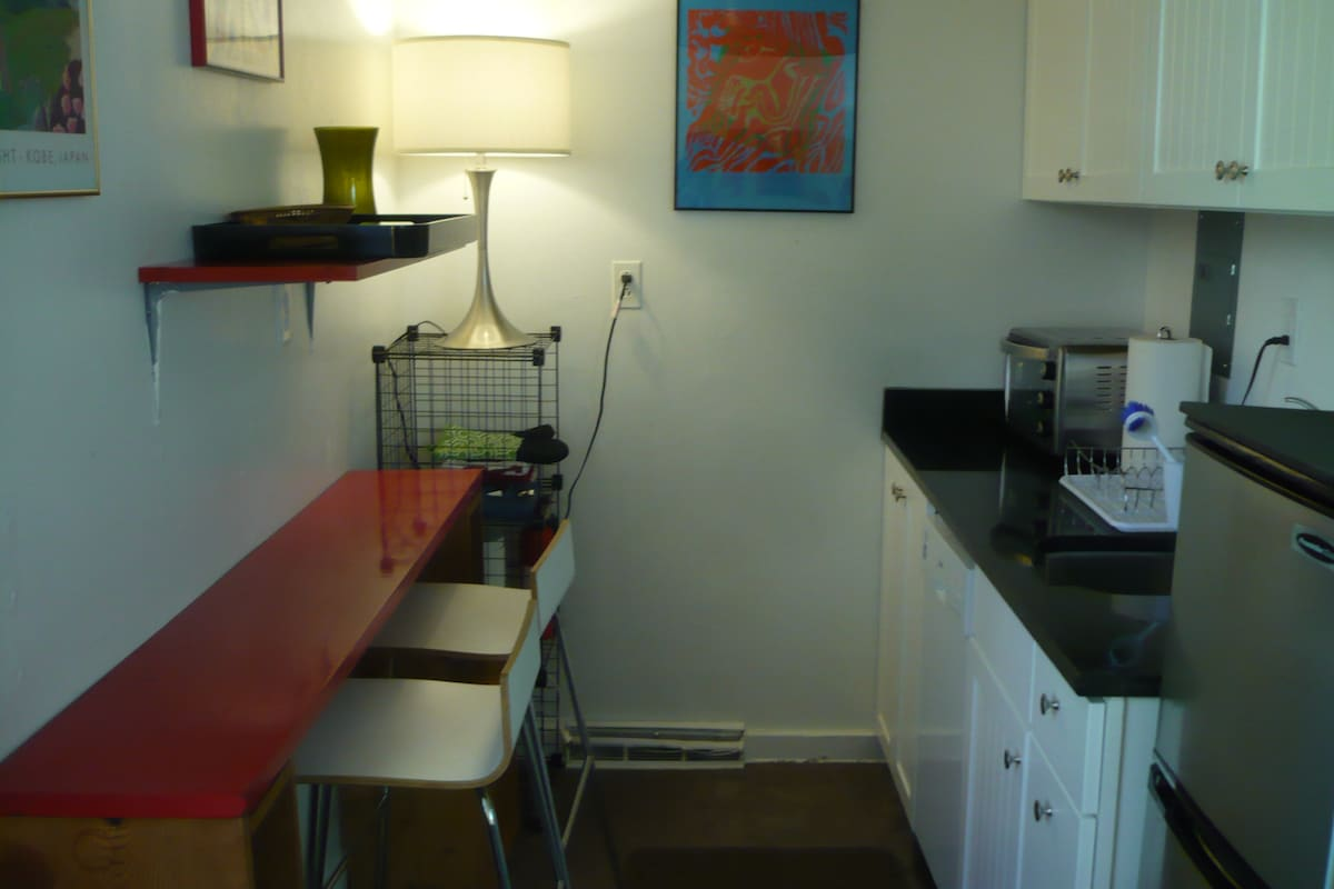 Just off the bedroom is a nook kitchenette, fully equipped for simple meals.