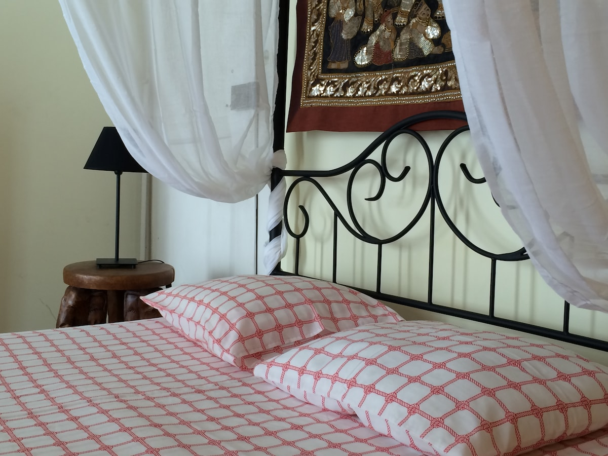 Large double canopy bed in main bed room