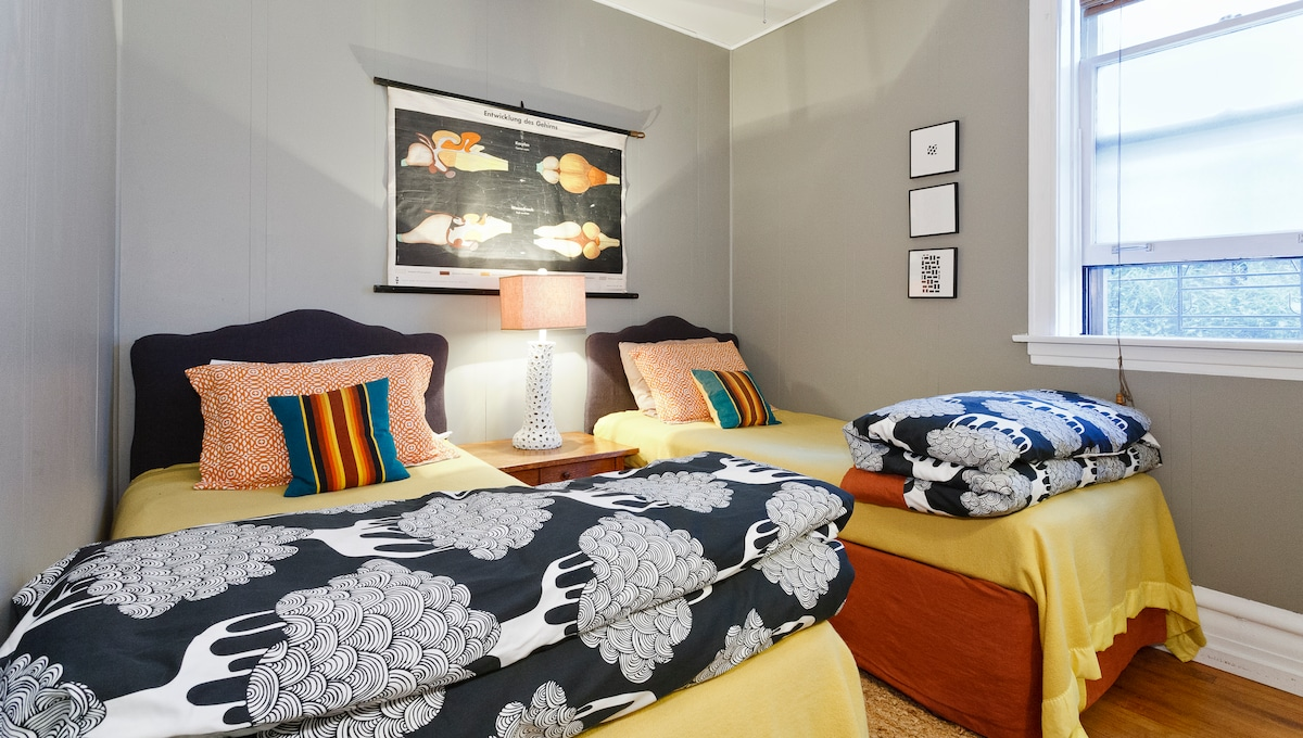 The second bedroom is outfitted with a pair of twin beds and cozy comforters.
