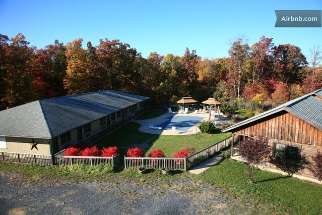 Lodge on the Left, Cabins on the right, Pool and Gazebos