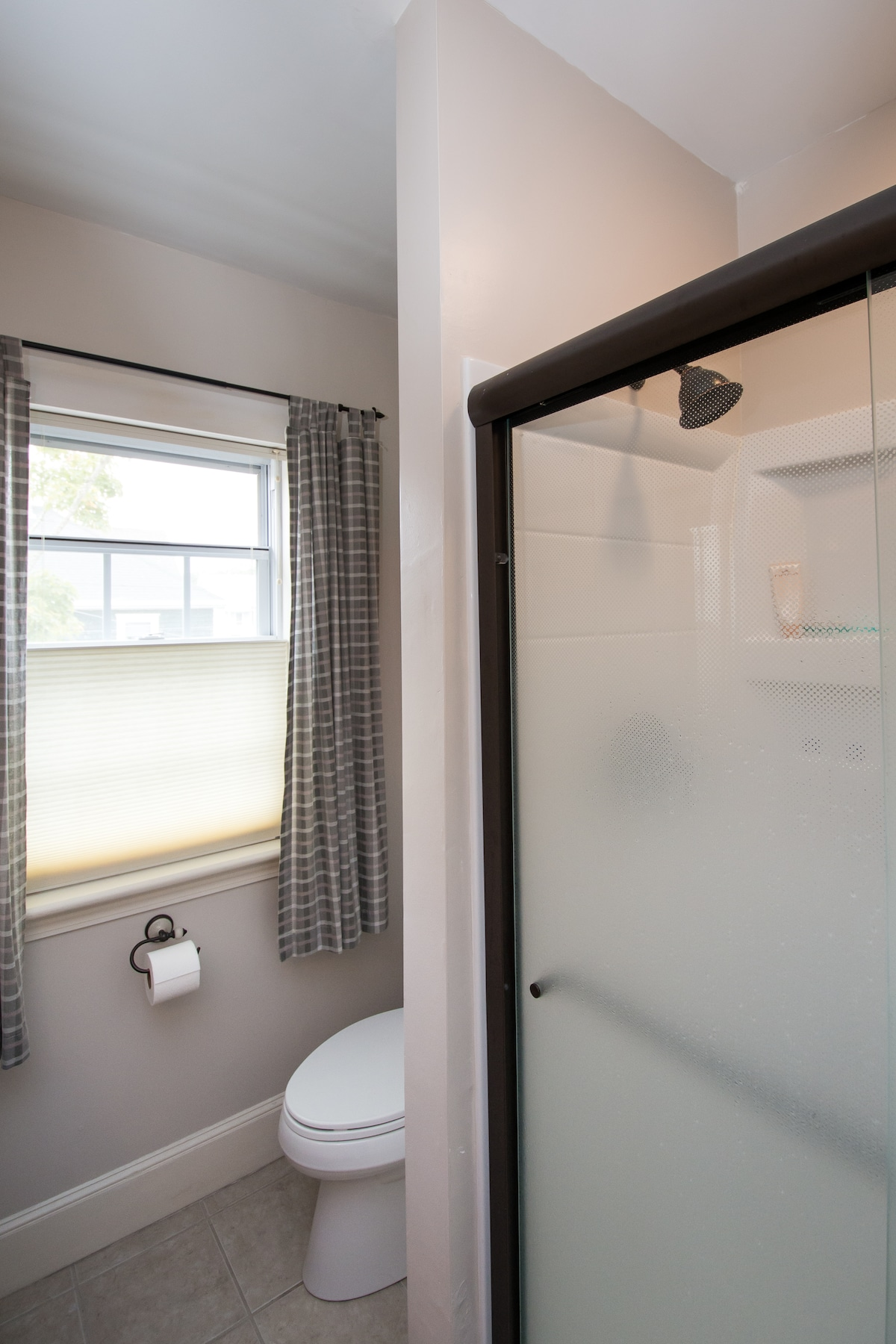 Another view of 2nd floor bathroom which includes an extra wide walk-in shower.