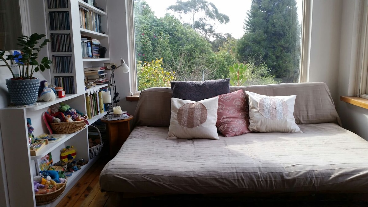 Sunroom/study with double futon daybed.