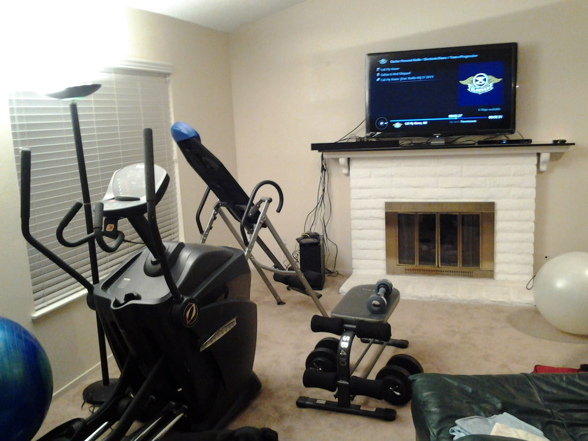 """55"""" LED TV, exercise equipment, fireplace. What more can you ask for?"""