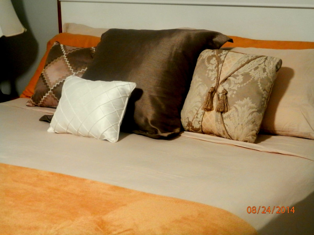 Same king bed just different sheets and arrangement.