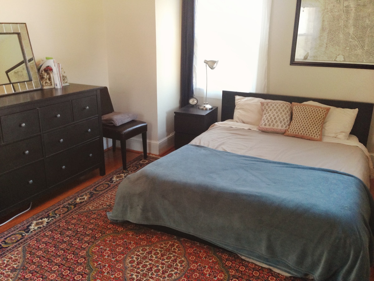 View 2 of bedroom, empty dresser and side table so you feel at home. We provide towels and linens as well.