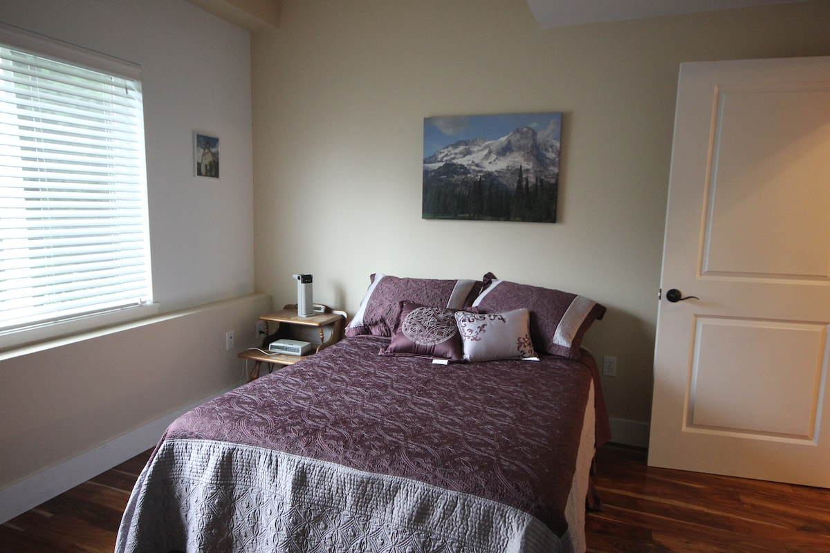 Cozy bedroom with double bed and  south facing window.