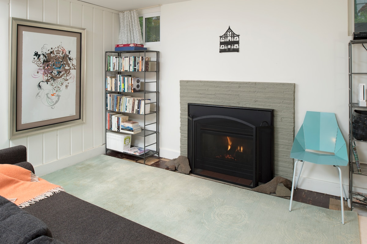 The bedroom fireplace is cozy to sit in front of after a busy day.