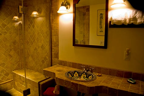 Terra cotta tiles line the shower and bench seat as well as the vanity in the bathroom. A sumptuous experience....