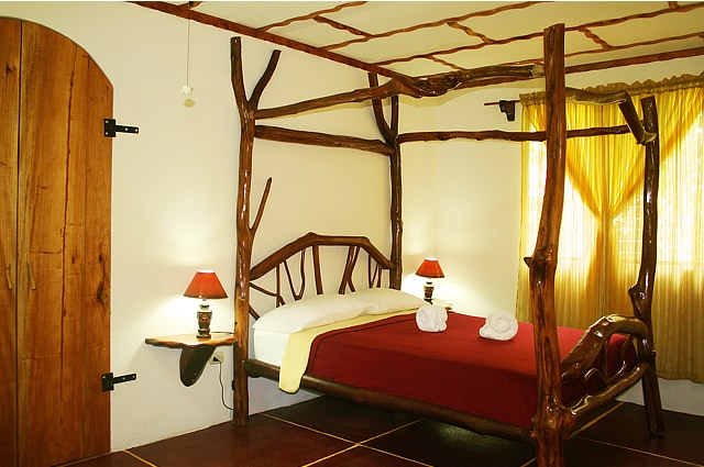 Casita bedroom with handmade guava wood bed