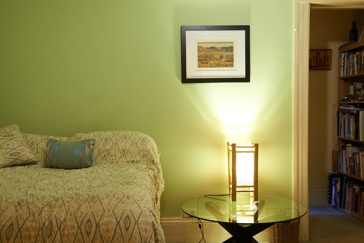 Cozy comfortable bed awaits you. Bathroom is on the other side of the door,