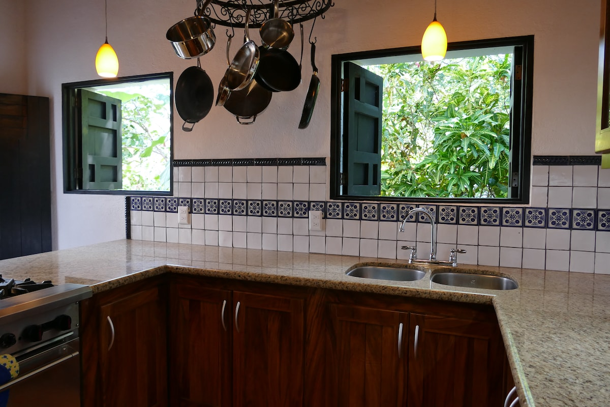 Lower House kitchen - granite counters and talavera tile