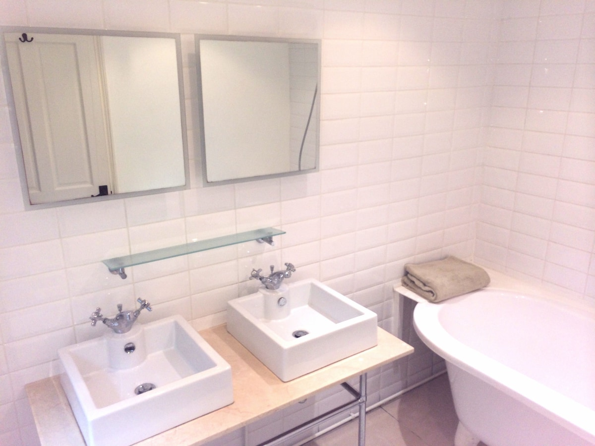 Double bathroom with deep, free standing bath and shower.