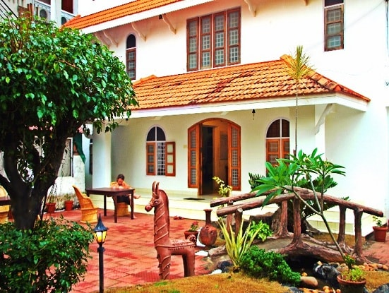 Front View of Vedanta Wake up! by the backwaters, Fort Kochi