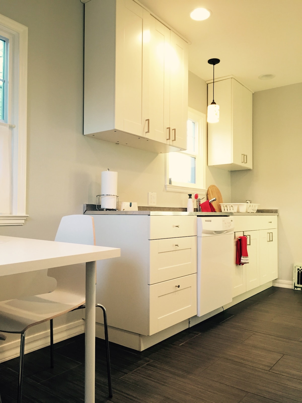 Bright, clean kitchen with a small table for two. Everything you need to make a nice meal. Dishwasher included!.