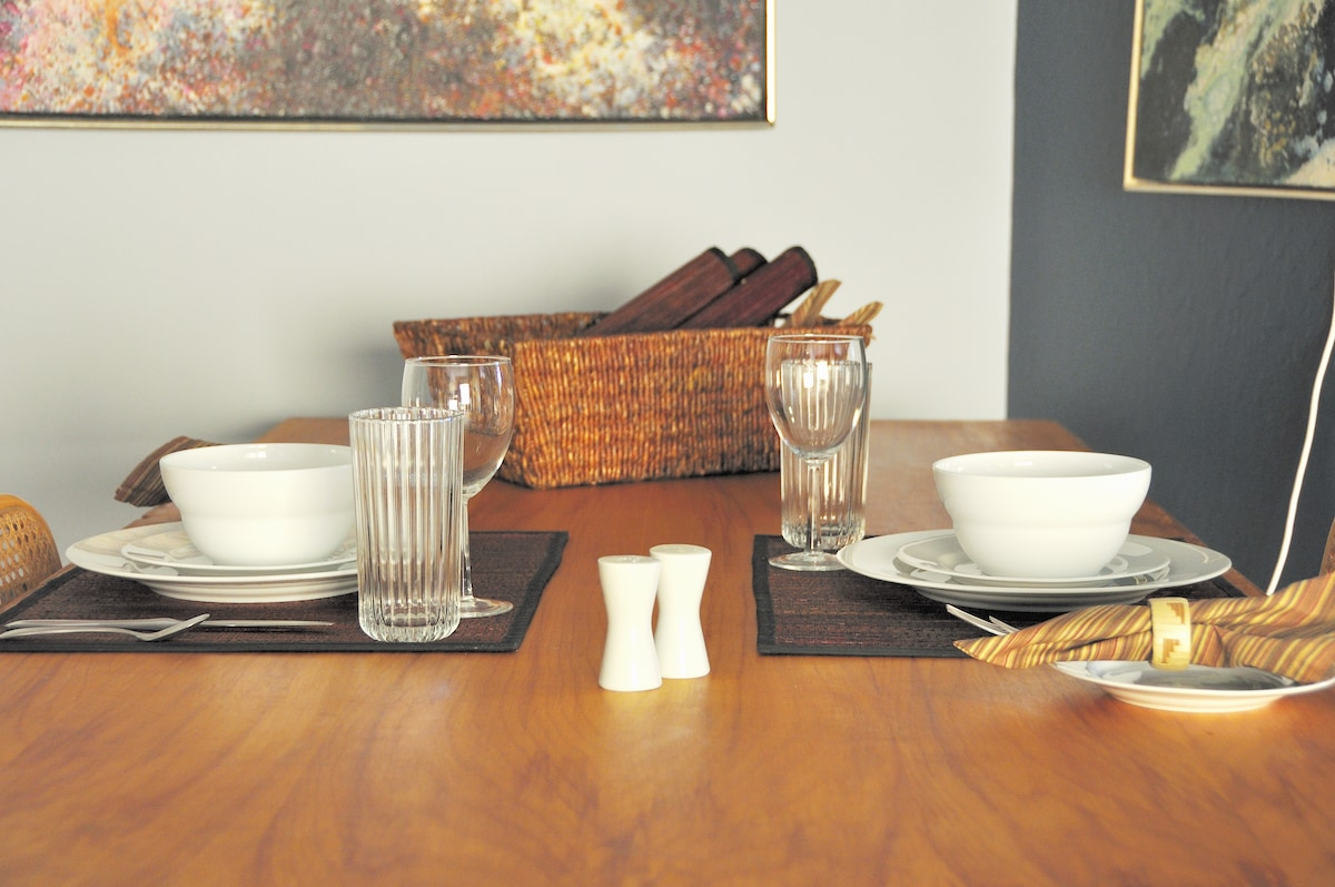 Table linens and setting for four are provided.