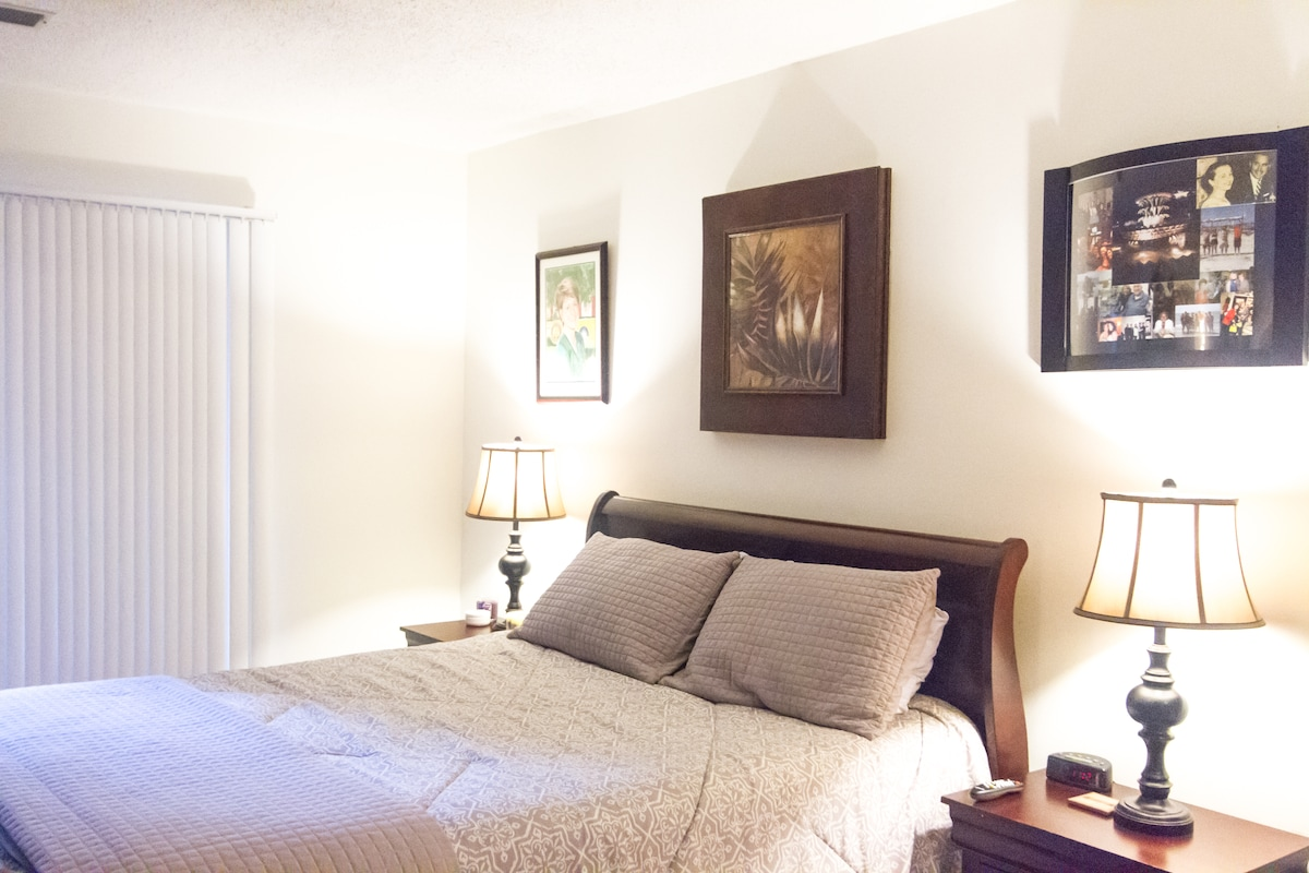 Master Bedroom with ensuite bath and sliding glass door to patio.