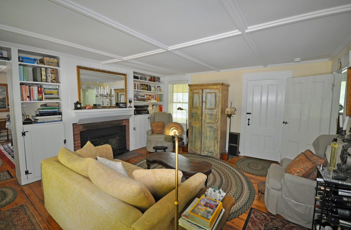 Both the Joy and Wish Rooms are off to the left of the Living Room, door to staircase is closed and Dining Room is off to the right.