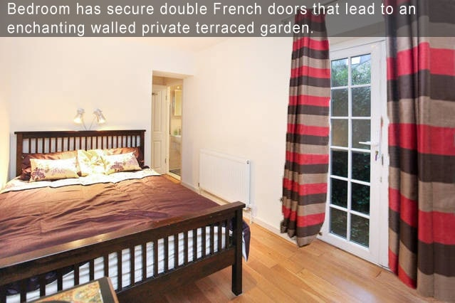 Bedroom has secure double French doors that lead to an  enchanting walled private terraced garden.