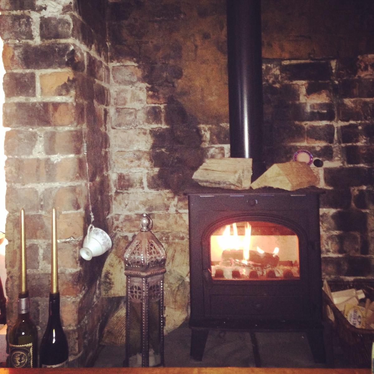 The new wood-burning stove... Toastie warm!