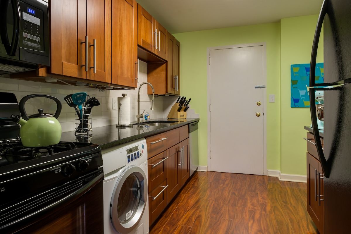 Remodeled kitchen with granite, gas stove, and all the cooking supplies you'll need.