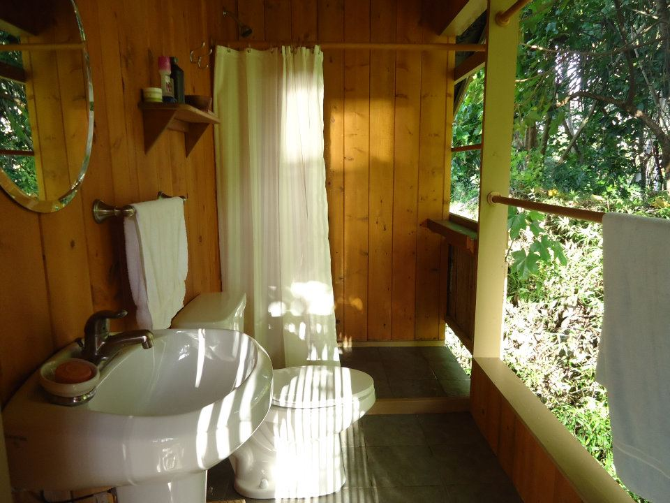 Jungle observatory and bathroom with flush toilet and hot showers.