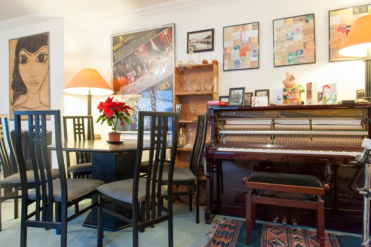 Main living room. Everyone is welcome to use the musical instruments
