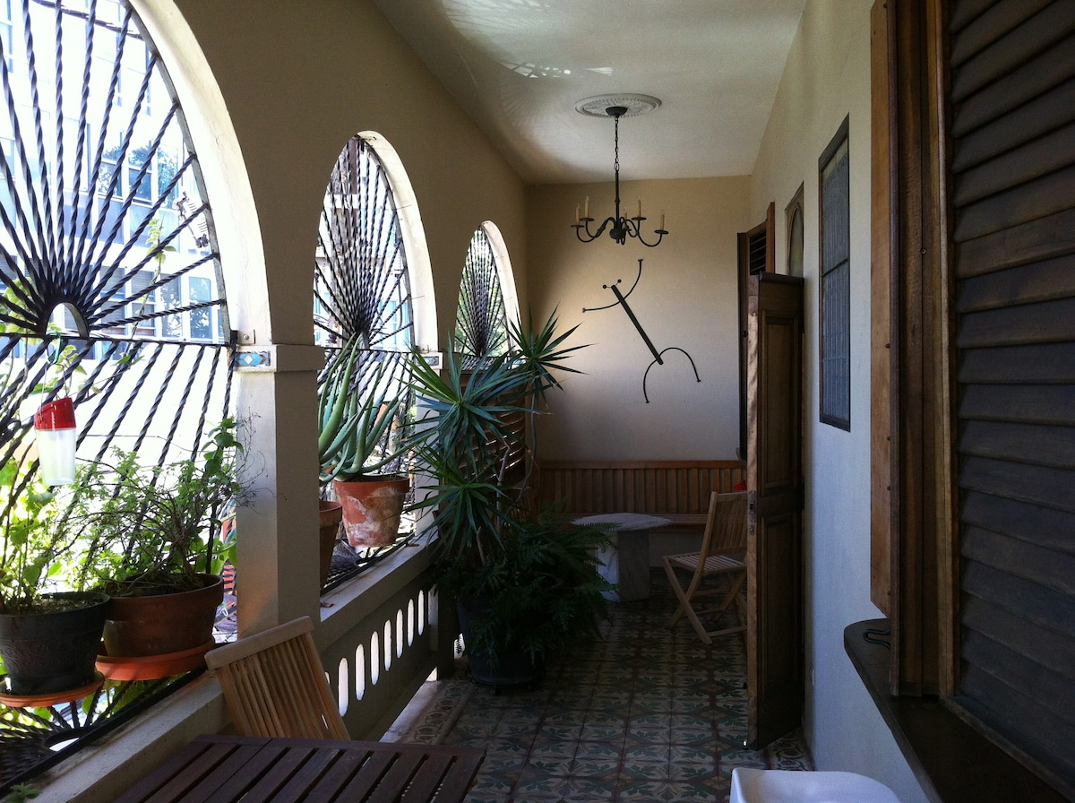 Your private balcony with seating area, dining area, pass-through to kitchen with bar stools and herb/aloe garden.