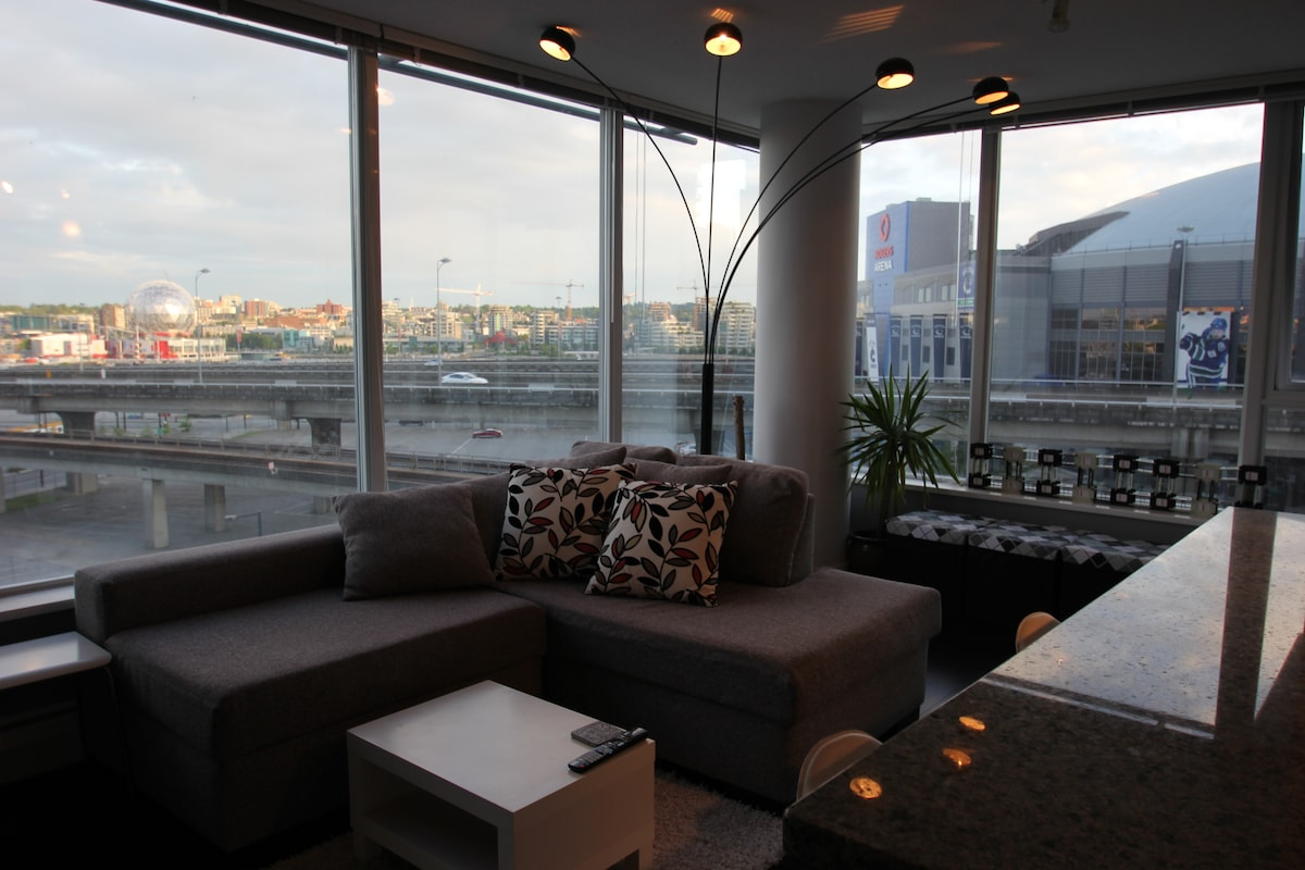 Living room with a view of Science World and False Creek