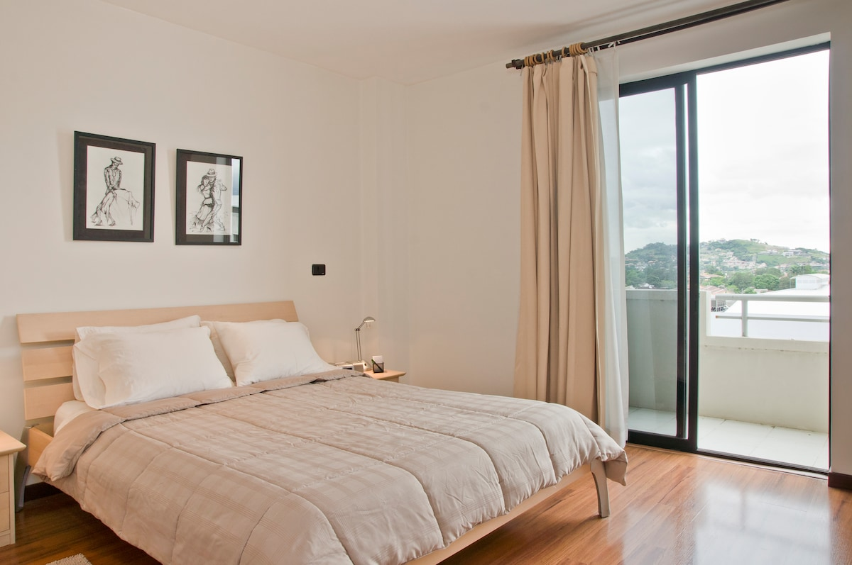 Master bedroom with own balcony, great view of the Escazu hills, sunsets and Avenida Escazu