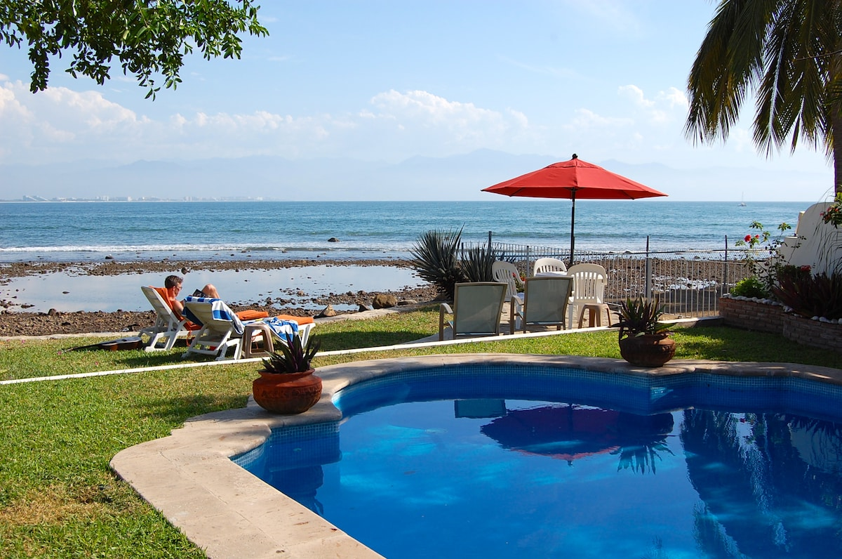 Views of the private pool and beach at low tide. Puerto Vallarta is far in the distance on the other side of Banderas Bay.