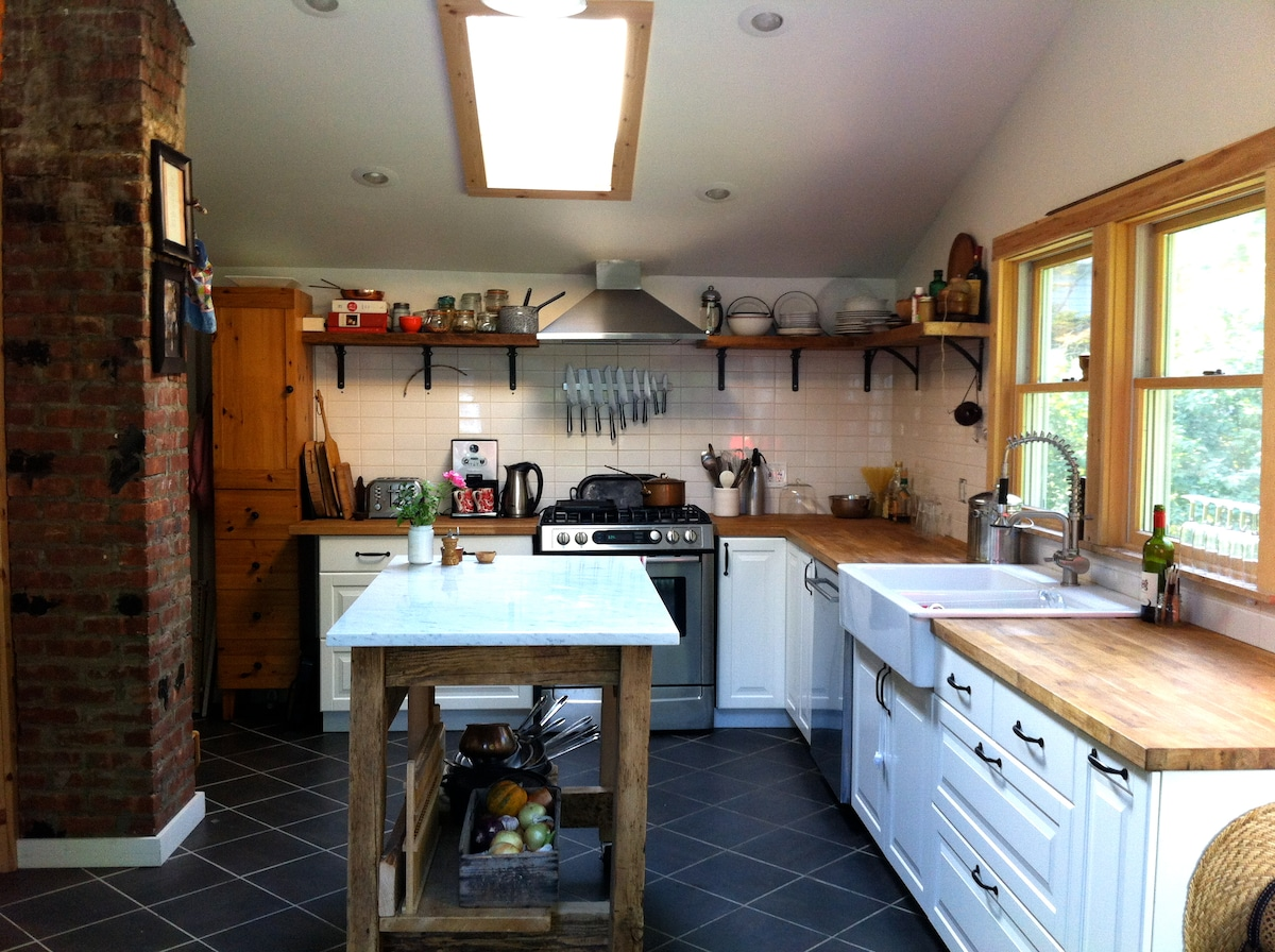 Skylights flood our ample kitchen with light. Fully stocked with knifes, copper and cast-iron pots and all the tools needed for simple to spectacular cooking adventures