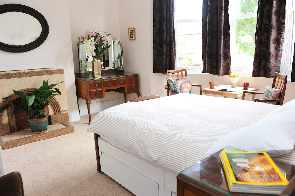 your airy spacious bedroom. A very comfy bed. And an aspidistra plant that will be 100 years old in 2014...