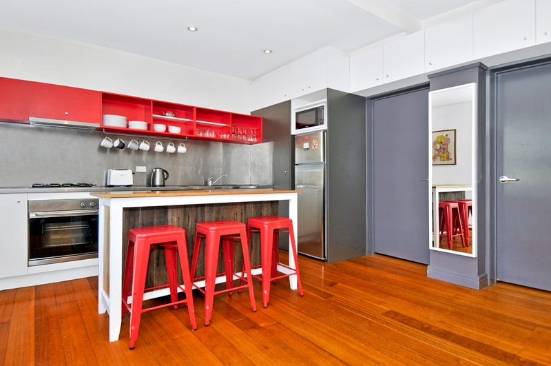 Fully equipped stainless steel kitchen with Oven, dishwasher, fridge and microwave.