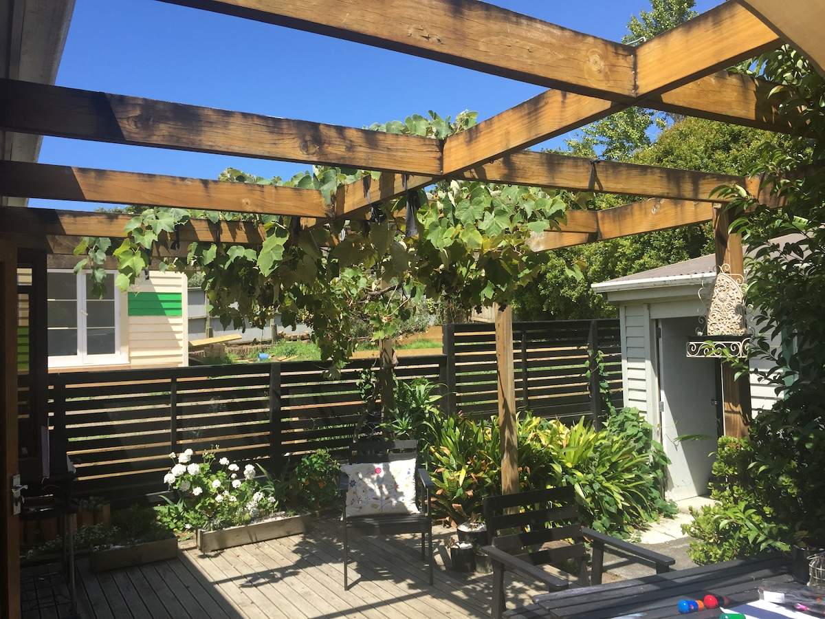 Our home is sunny, airy & comfortable, complete with a grapevine - your view from the breakfast table.