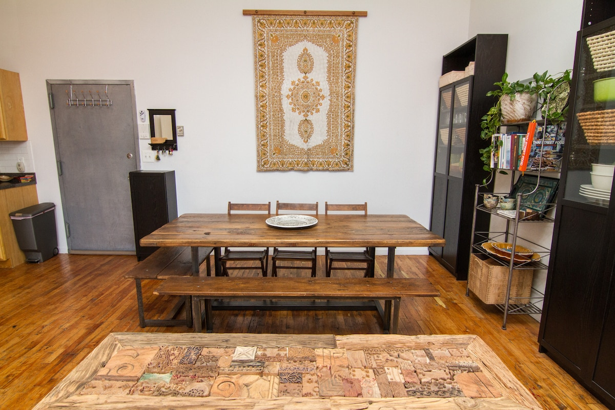 Dining table and benches custom-made from antique barn wood from upstate NY and hand-made silk tapestry from Kashmir, India