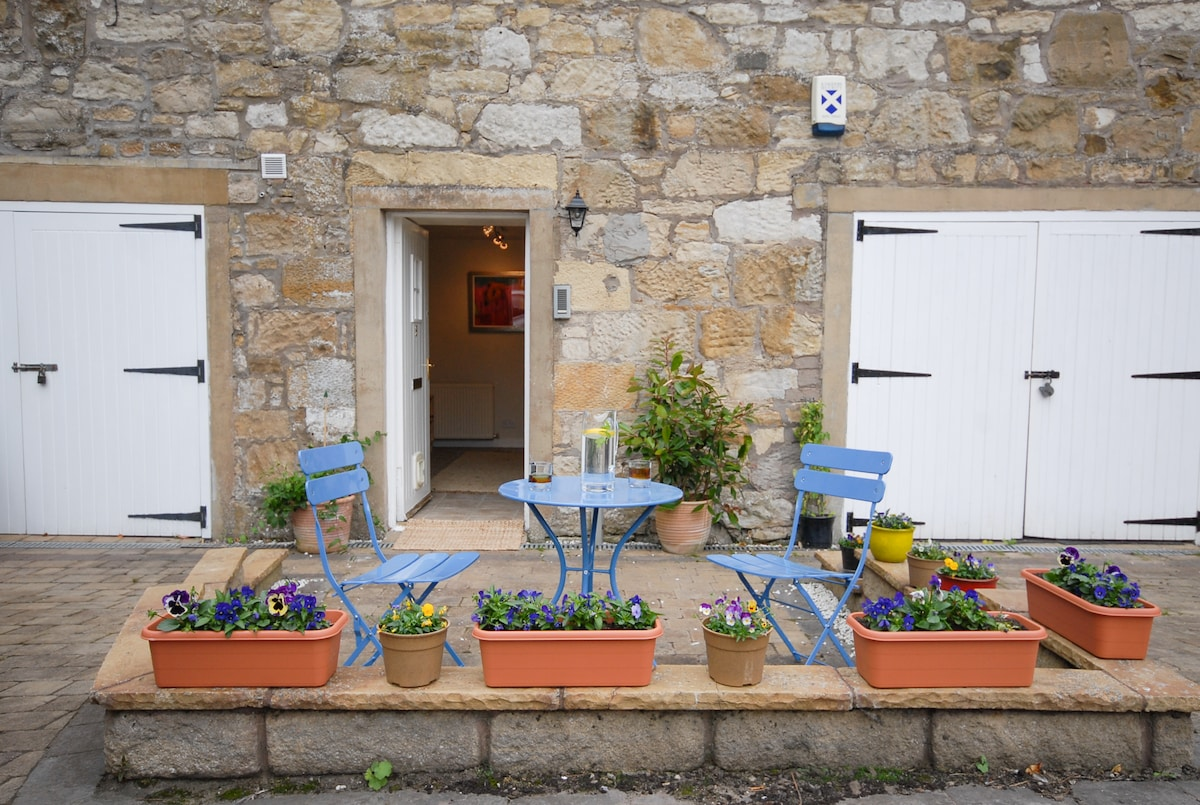 Enjoy a glass of wine in the courtyard