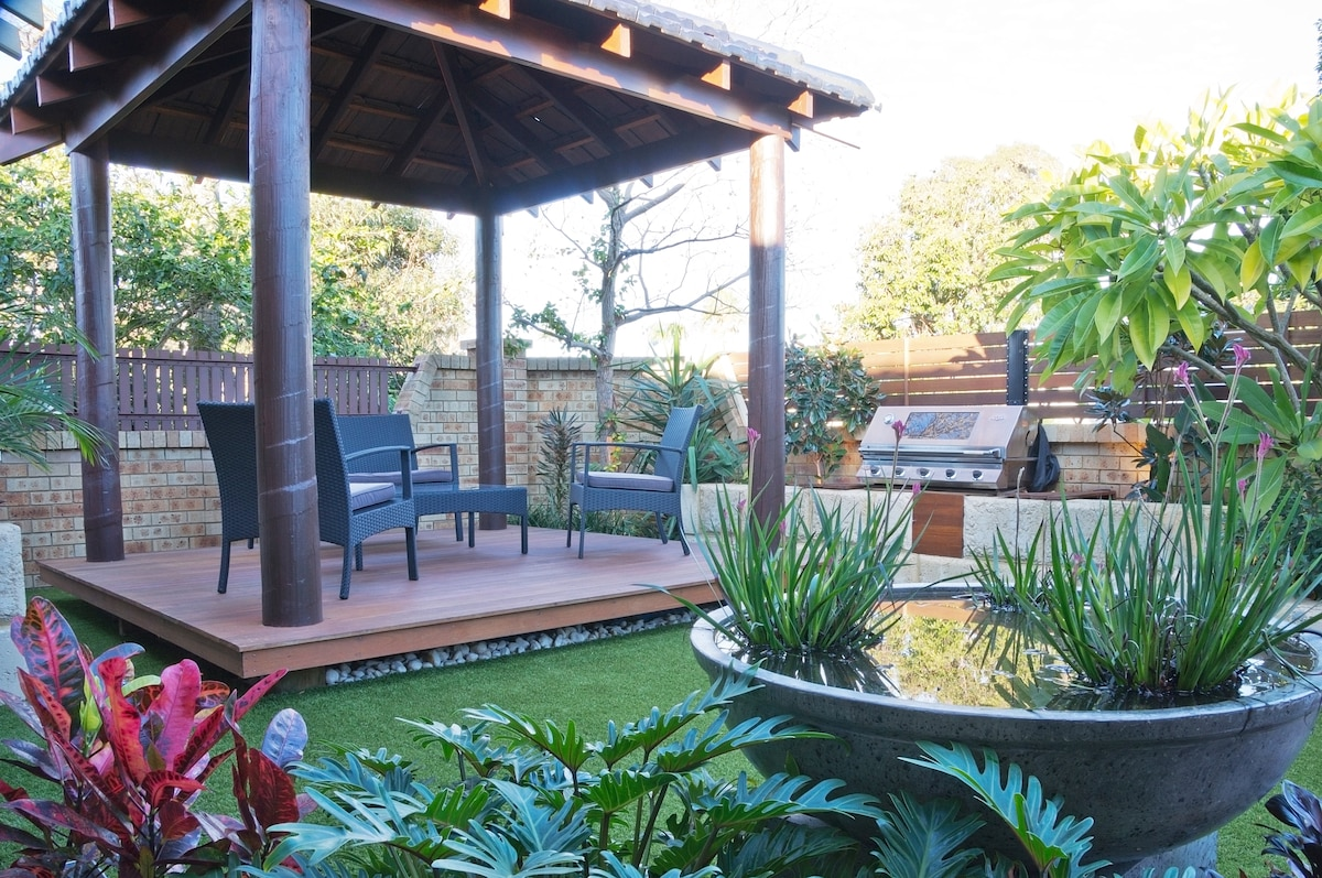 Front garden showing Balinese gazebo with built in Barbecue for entertaining friends