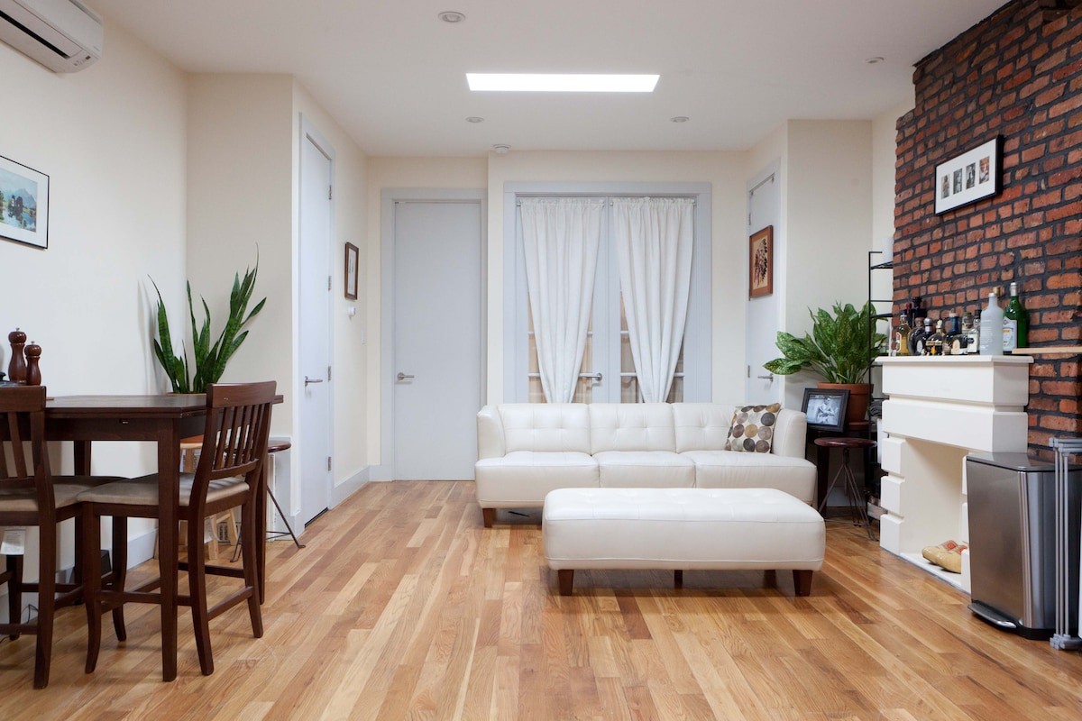 Spacious common area featuring skylight windows and modern furnishing