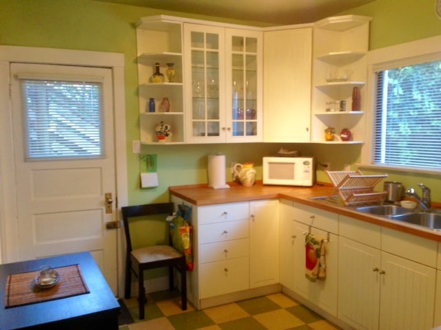 The famous green kitchen!  Bright, spacious and stocked with all the basics to make your stay easy.