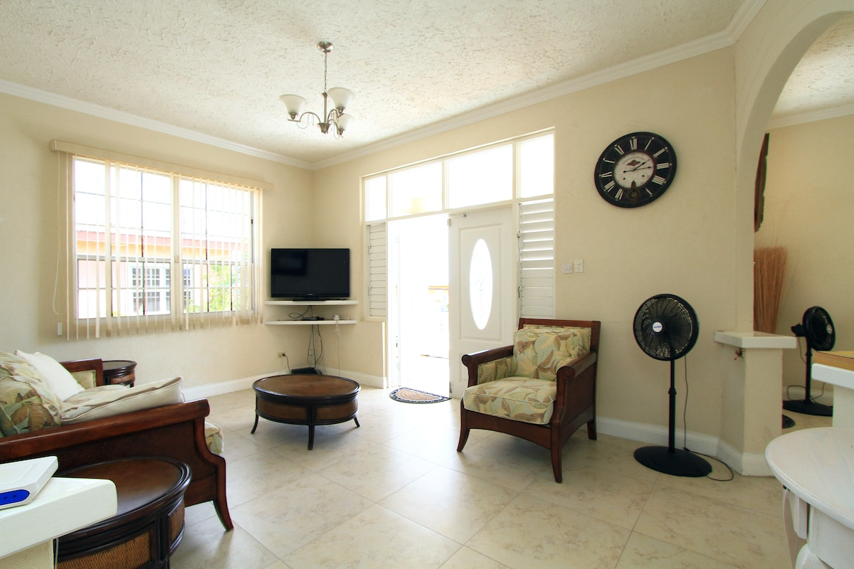 "Spacious living room with 32 "" Cable LCD TV and DVD Player , Living Room leading to Veranda."