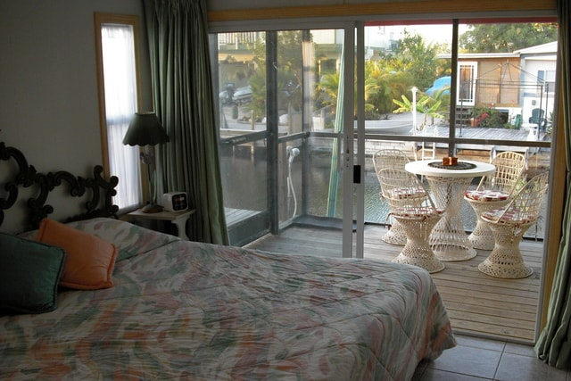Queen size bed leads to the screened in porch over looking the water. Step out and look down the canal to the bay & mangroves