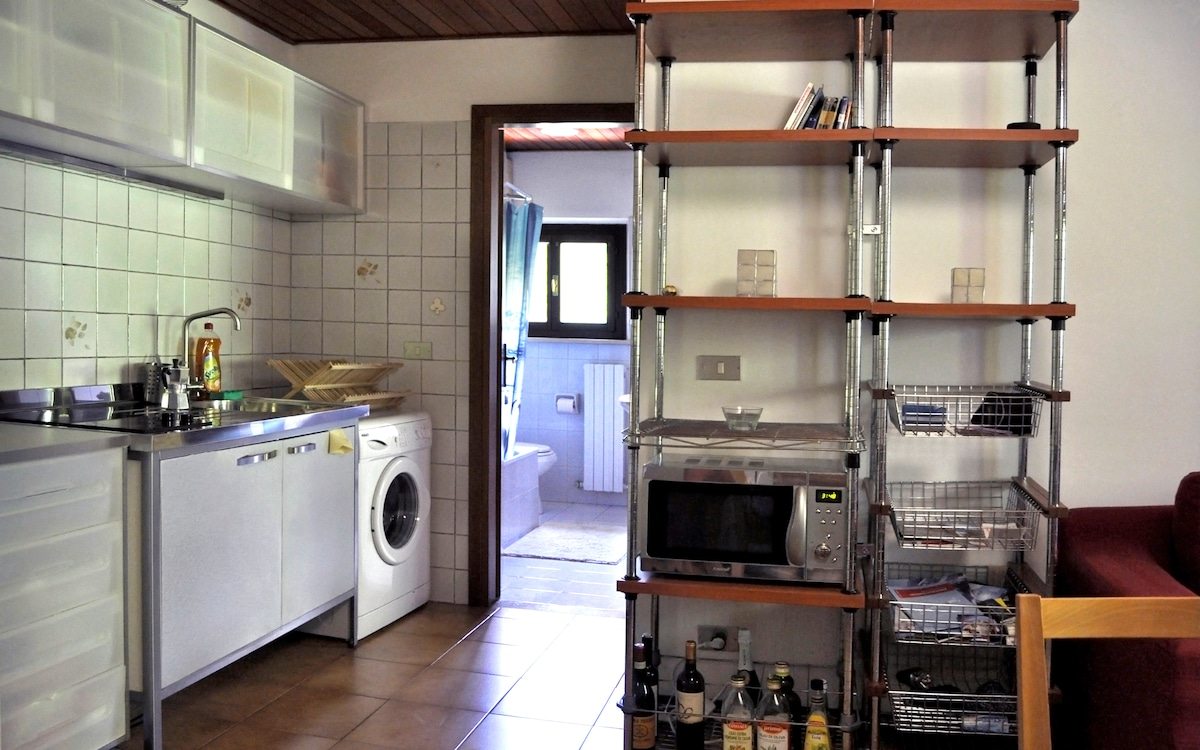 Kitchen facilities, with fridge, microwaves, cooking pads, sink, washing machines and full set fo stowage and cutlery