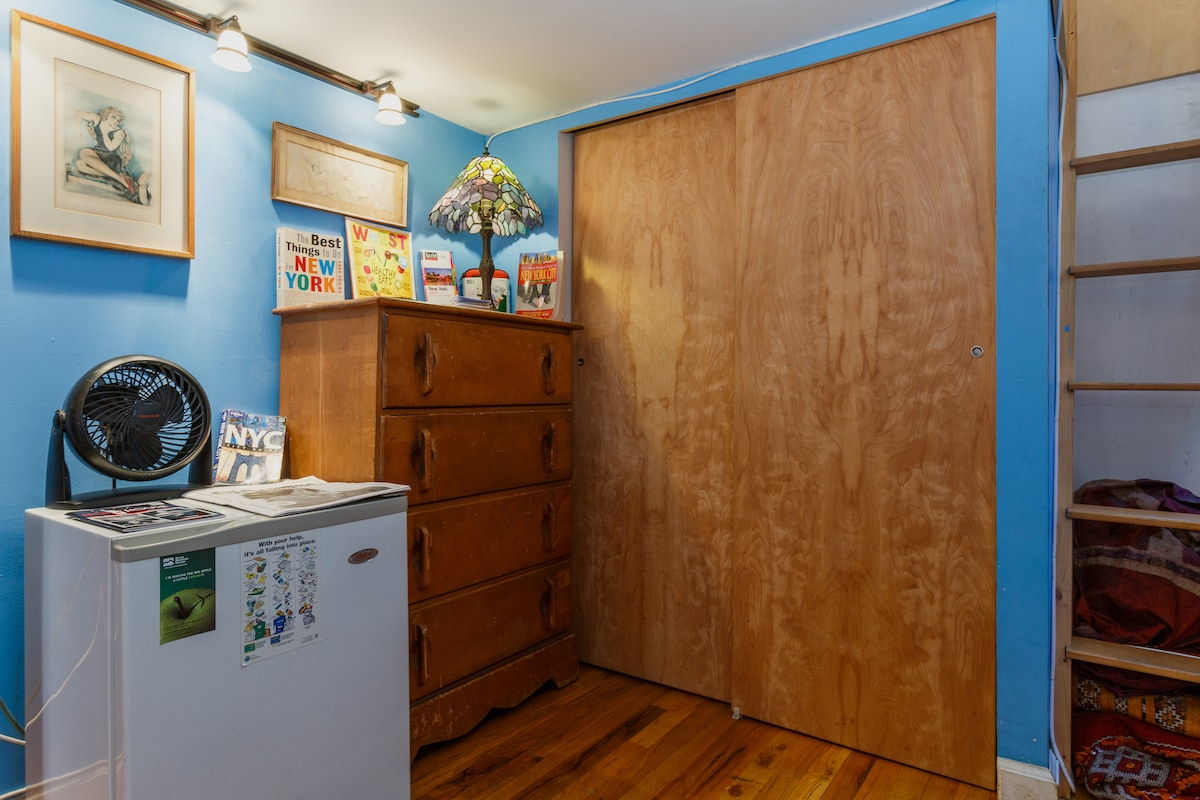 Here is your fully private room. You have half the closet to use to hang up your nice things in. You also have your own refrigerator.
